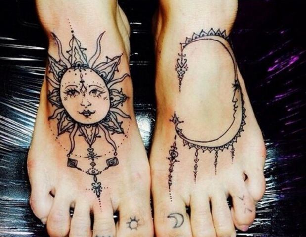 Sun and moon tattoos on the feet