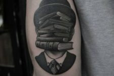 Surreal book tattoo on the arm