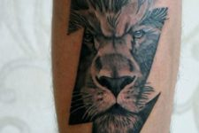Thunderbolt with lion face tattoo
