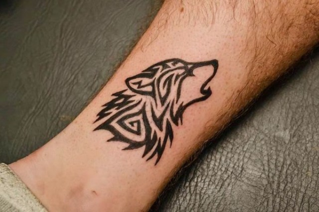 Tribal wolf tattoo on the ankle
