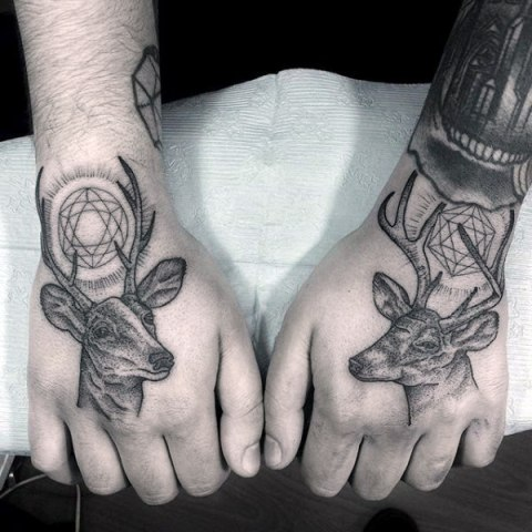 Two deer tattoos on the both hands