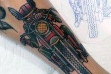Vintage bike tattoo on the arm