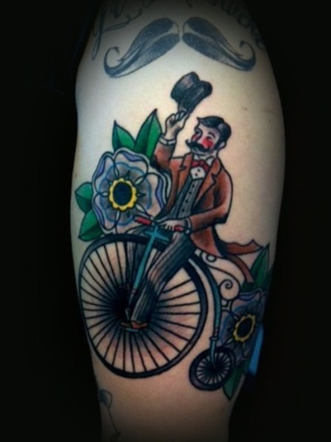 Vintage styled bicycle tattoo with flowers