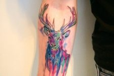 Watercolor deer tattoo on the arm