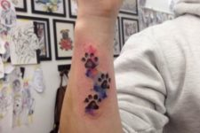 Watercolor paw tattoos on the arm