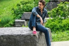 With denim shirt and jeans