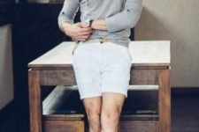 With gray hoodie and white shorts