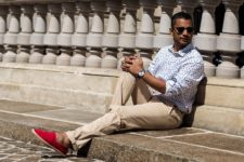 With polka dot shirt and camel trousers