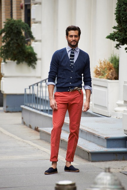 With printed shirt, striped tie, navy blue blazer and red pants