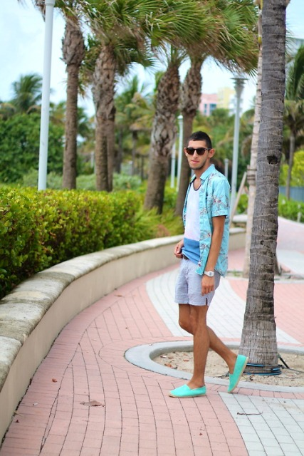 With t-shirt, turquoise shirt and gray shorts