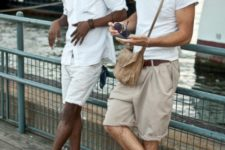 With white shirt, crossbody bag and beige shorts