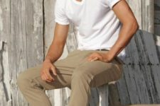 With white t-shirt, camel trousers and hat