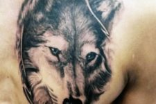 Wolf head tattoo on the chest