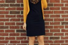 02 a black dress, a yellow cardigan, black leather booties, a leopard rpint scarf