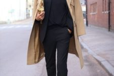 02 a black suit with a black top, burgundy booties and a camel coat