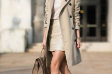 02 a neutral look with a classic beige trench coat with black buttons for work