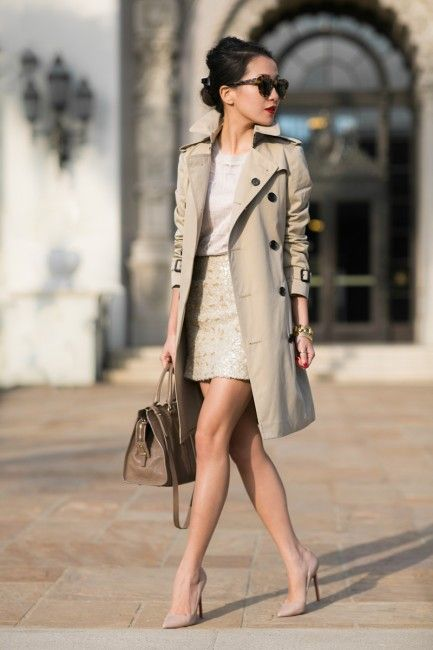 a neutral look with a classic beige trench coat with black buttons for work