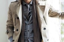 02 a neutral trench, pants, a vest, a polka dot shirt and a polka dot tie for a layered fall look
