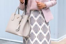 02 a pink striped top, a pink jacket, a printed knee skirt in pastel shades and a neutral bag