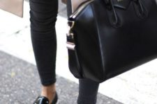 02 an average size black leather bag is classics that fits many occasions