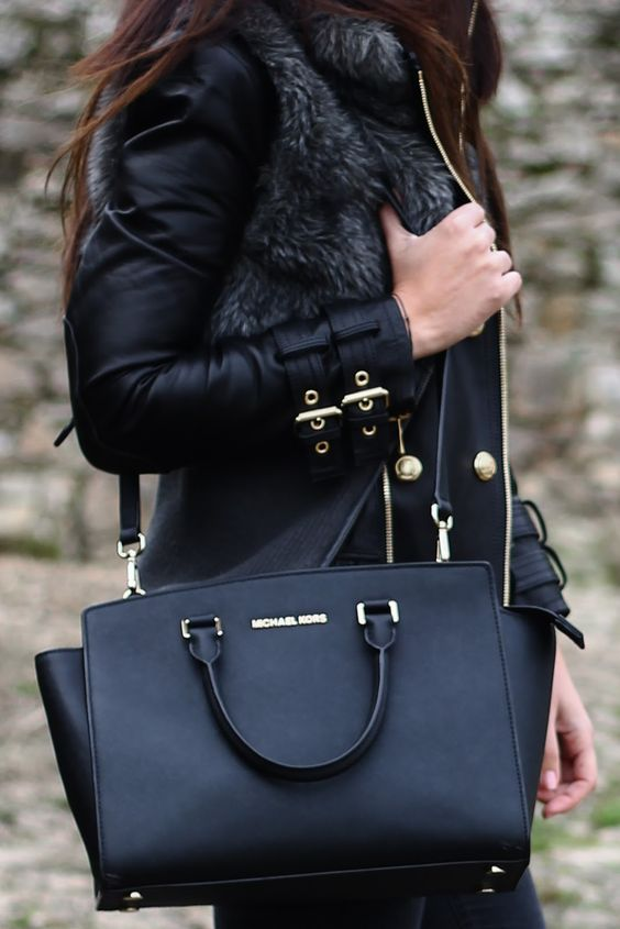 a black bag with a long strap can be worn on the shoulder too