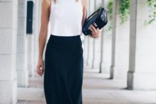 03 a black midi skirt, a white sleeveless crop top, black spiked shoes and a black bag