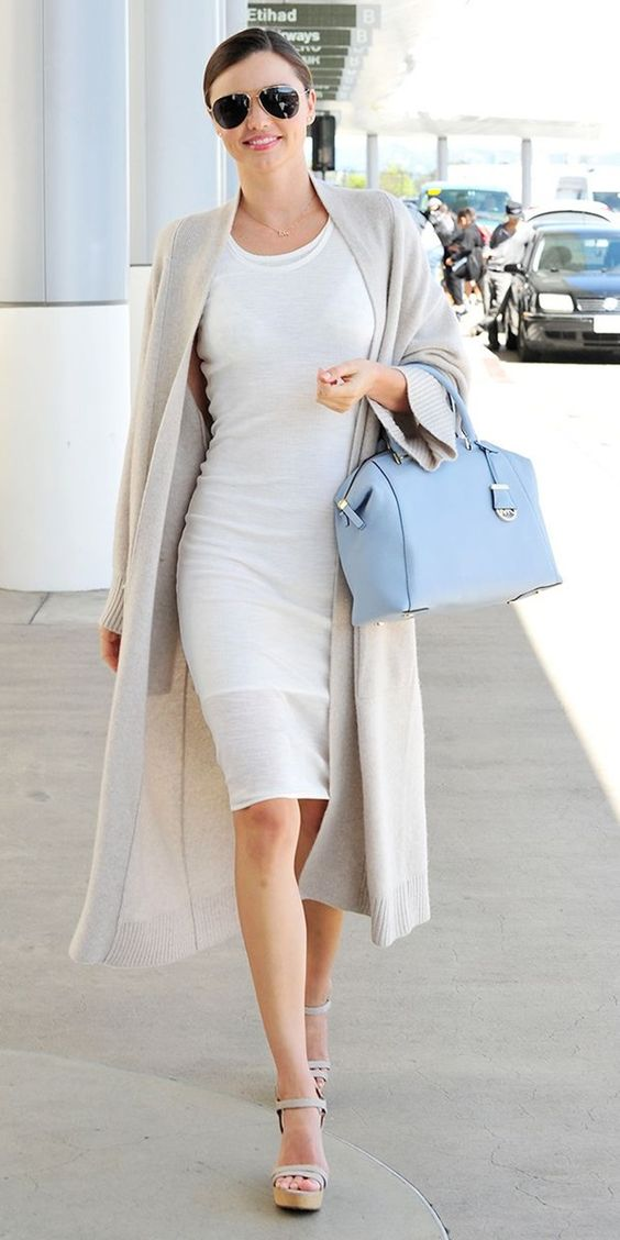 a cream knee dress, a neutral long cardigan, nude shoes and a serenity blue bag