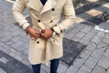 03 a neutral beige trench, jeans, brown shoes and a navy sweater for a casual fall look