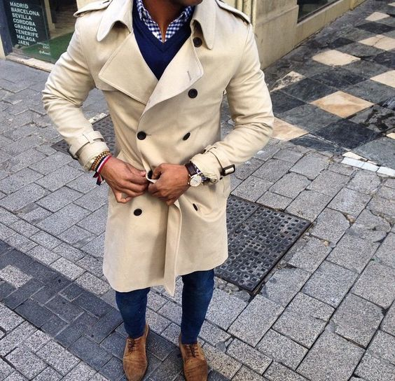 a neutral beige trench, jeans, brown shoes and a navy sweater for a casual fall look