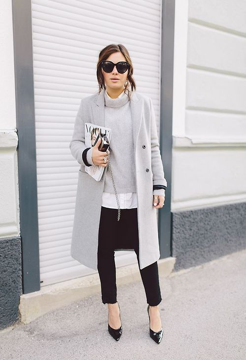 black skinnies, a white shirt, a grey sweater, black heels, a grey coat
