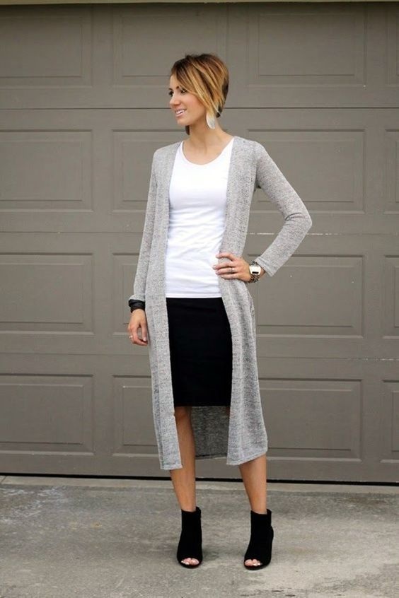 a black knee skirt, a white top, a long grey cardigan and black suede peep toe boots