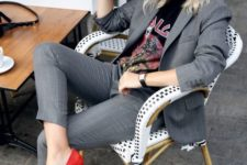 04 a grey thin striped suit with a rock tee and red suede heels