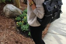 04 a neutral chunky knit sweater, black leggings, black booties and a black backpack