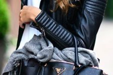 04 a textural black bag with a long strap is ideal to go to work