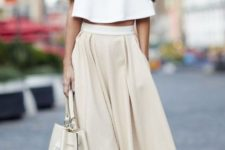 04 a white crop top with ruffles, a neutral high waisted skirt, snake print shoes and a bag