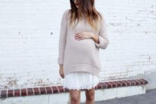 04 a white lace dress, a neutral sweater over it and nude pumps