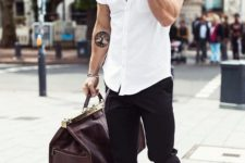 04 a white shirt with short sleeves, black pants, white chucks and a travel bag
