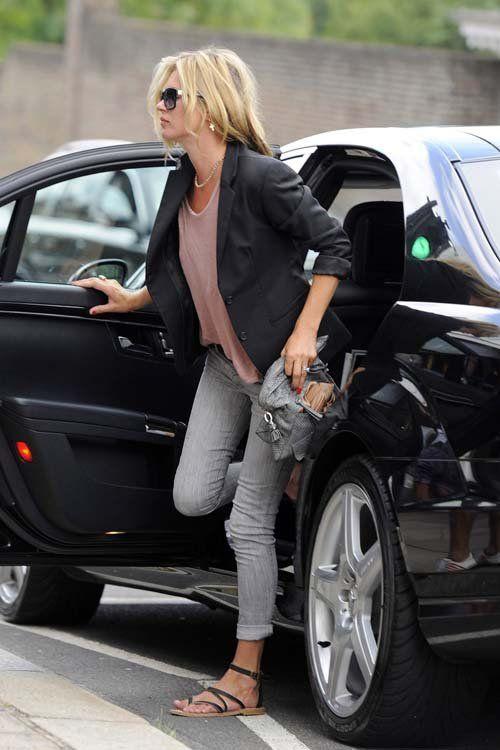 grey jeans, a pink top, a black blazer, black strappy sandals