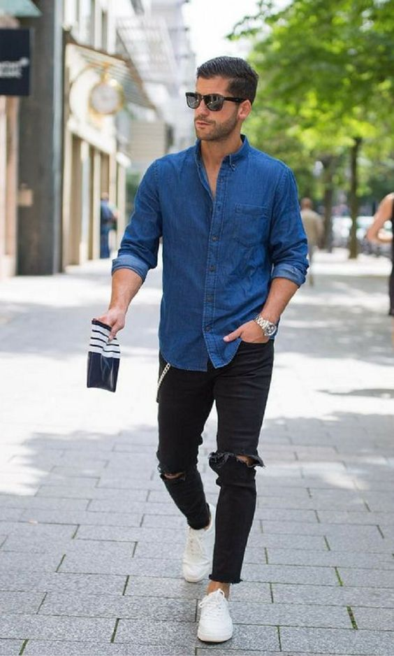 a chambray shirt, black ripped jeans and white sneakers