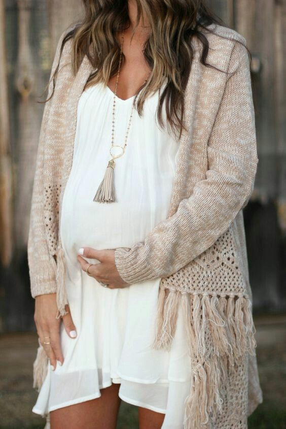 a creamy chiffon dress with a V-neckline, a tassel necklace and a neutral cardigan with tassels