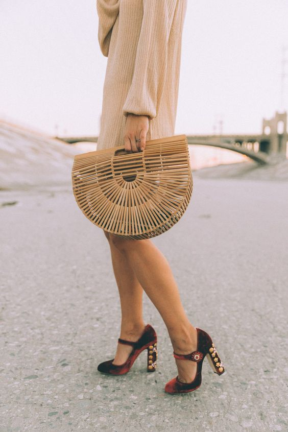 a neutral sweater dress and burgundy velvet shoes with whimsy heels