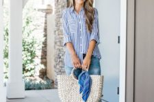 05 blue jeans, a striped blue and white shirt, striped flats and a wicker bag for a casual summer look
