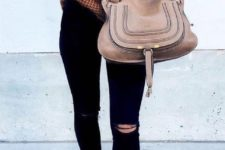 05 brown lace up sandals, black ripped skinnies, a brown off the shoulder sweater and a large bag