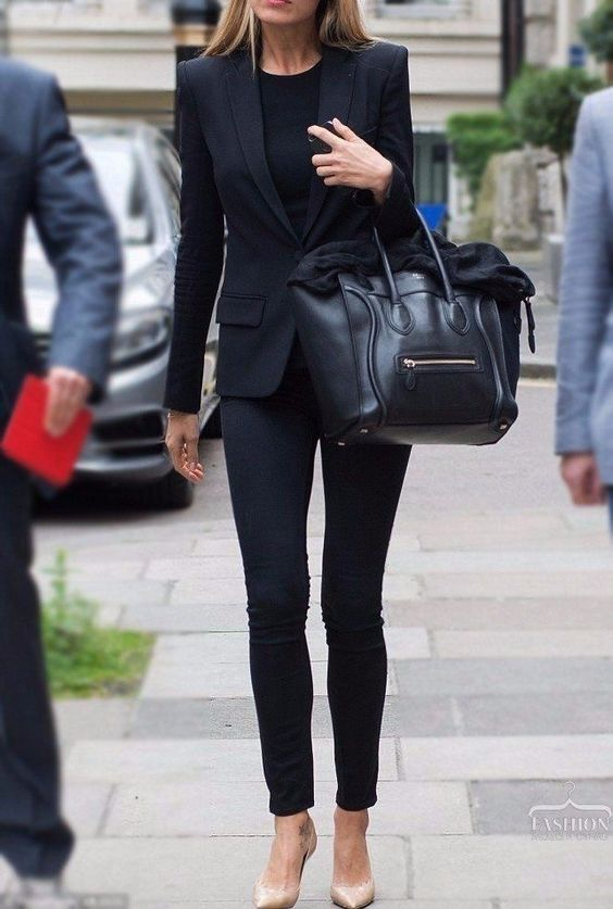 navy skinnies, a black top, a black blazer and nude heels for a chic look