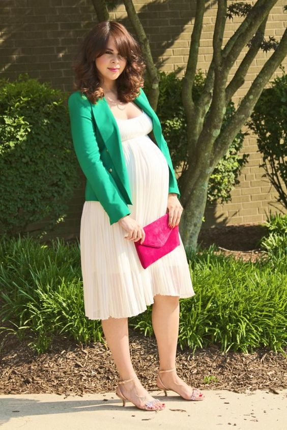 a cozy fall look with a comfy knee white dress with a pleated skirt, an emerald blazer, nude heels and a pink clutch