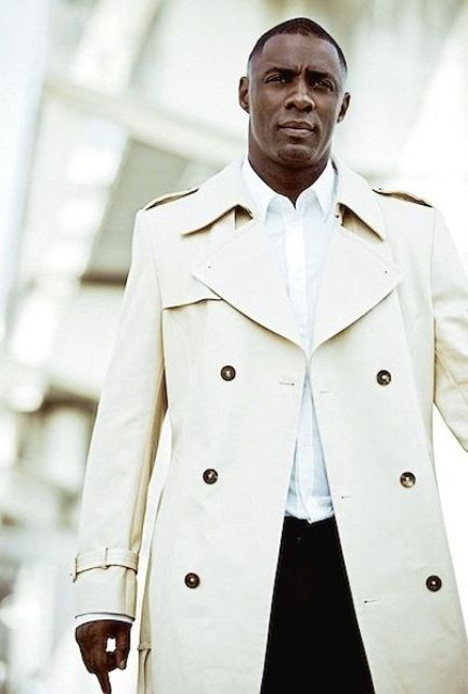 a gorgeous look with blakc pants, a white shirt and a cream trench coat