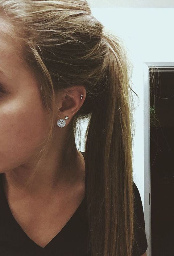 a large stud earring with several smaller ones look very modern and chic