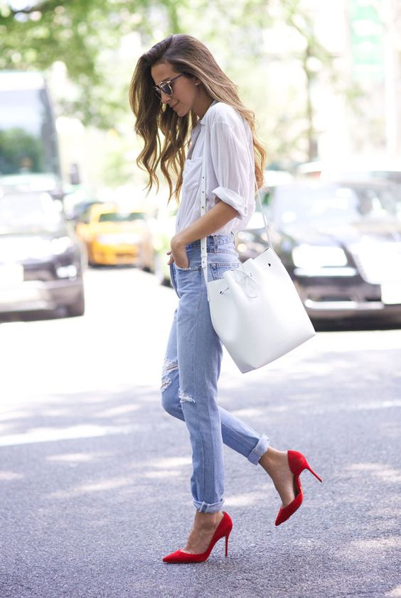 a white shirt, blue distressed jeans, red heels and a white tote