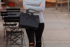 06 ripped black skinnies, a grey off the shoulder sweater, black heels and a bag