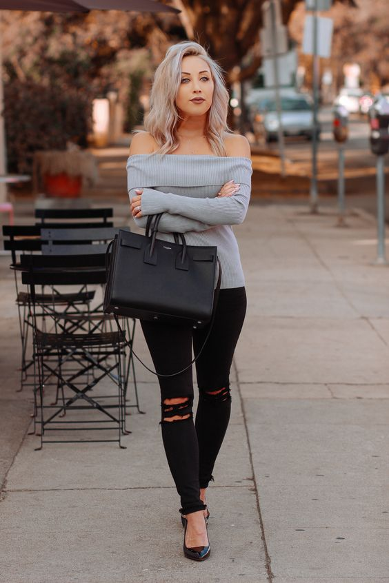 ripped black skinnies, a grey off the shoulder sweater, black heels and a bag